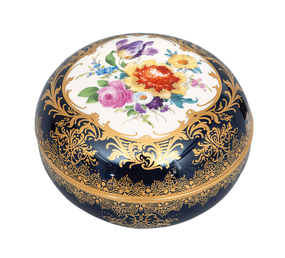 A cobalt-blue box with flower painting