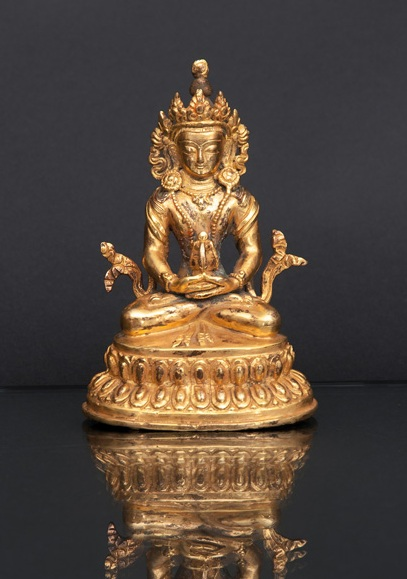 A miniature figure of a seated 'Amithaba'
