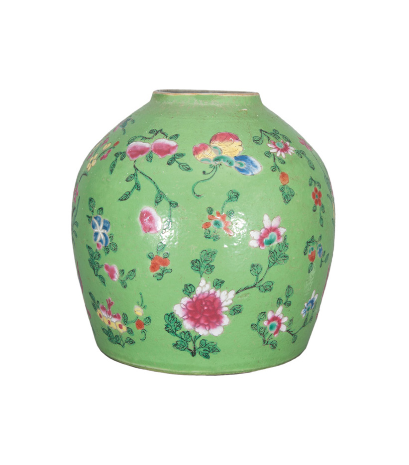 An apple-green ginger jar with flower decoration and butterflies