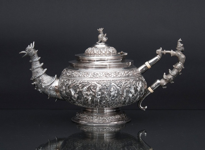 A fine silver repoussé teapot with sumptuous relief decoration