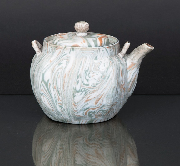 An unusual marbled pottery teapot