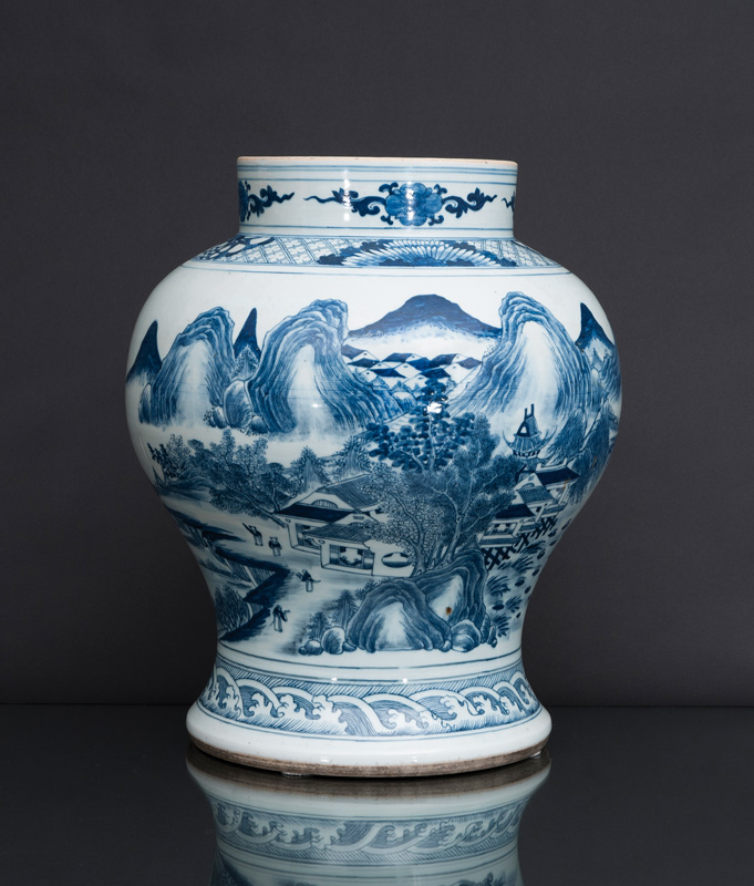 A tall articulated baluster vase with landscape scene