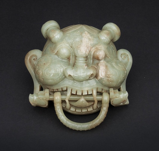 A highly unusual jade mask in the shape of a door knocker