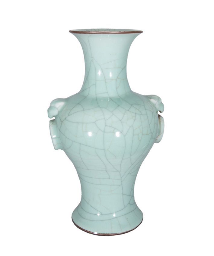 A celadon baluster vase with lion handles.
