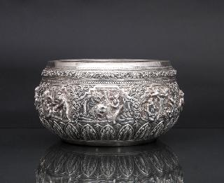 A large silver repoussé bowl with figural relief
