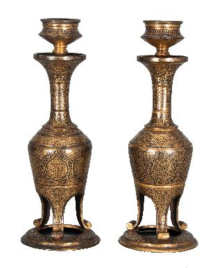 A pair of fine 'koftgari' candlesticks
