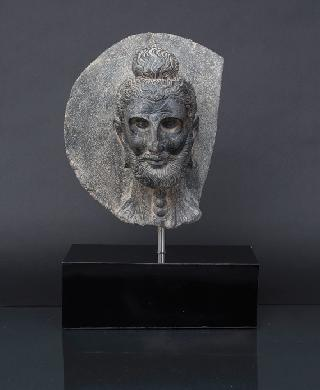A rare Gandhara head of a 'Fasting Buddha'