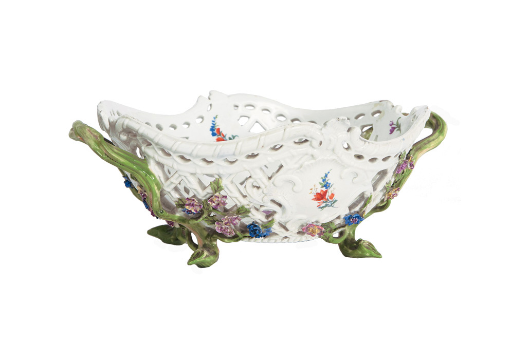 An fretwork basket with flower decoration