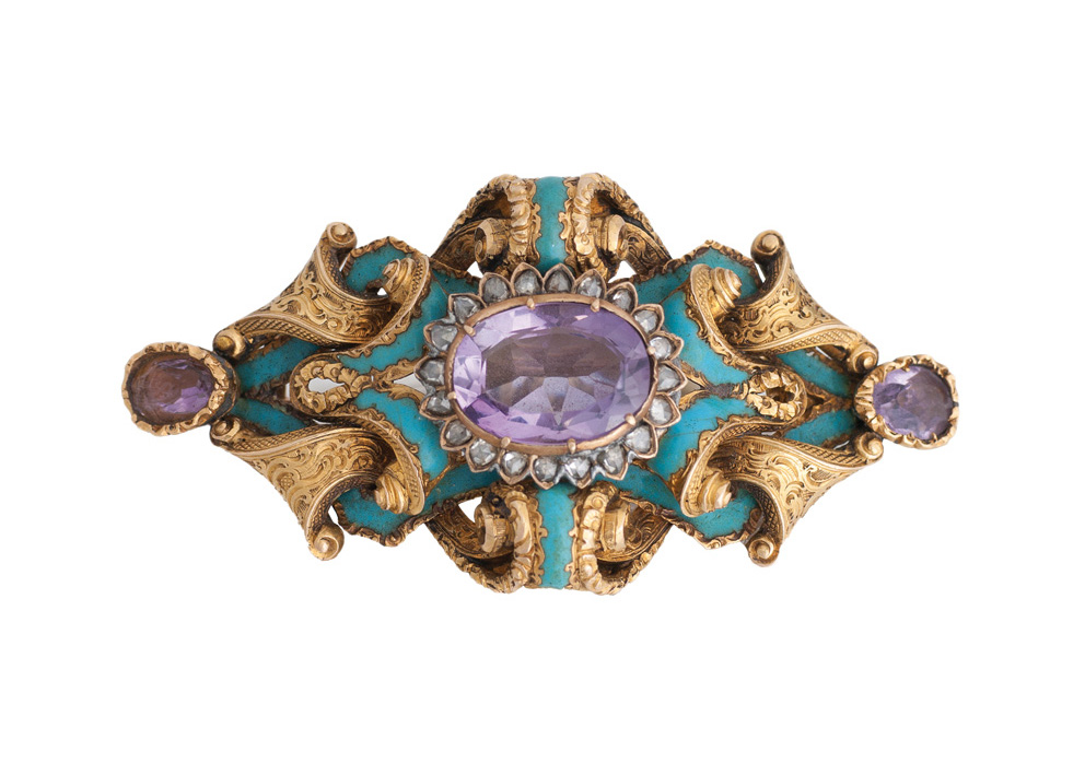 An antique turquoise amethyst brooch with rose cut diamonds