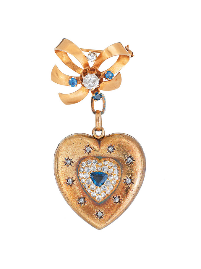 A heart shaped medaillon with diamonds and sapphires and brooch