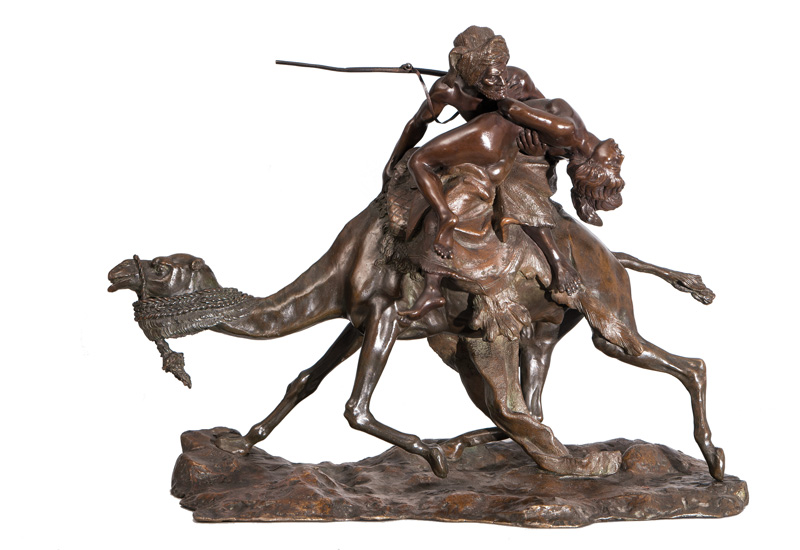 A large bronze figure 'Arab warrior abducting a woman'