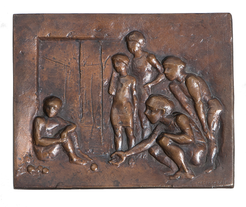 A bronze relief 'Children playing marble'