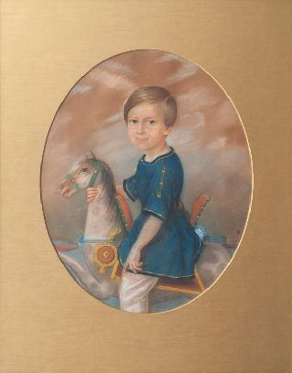 Portrait of a Boy on a Rocking Horse