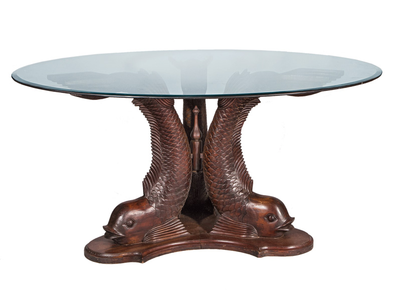 An interesting table with dolphin feet