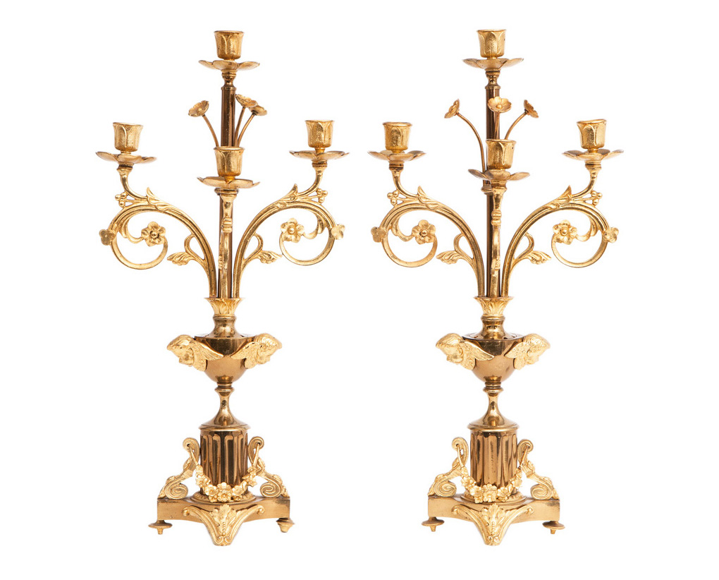 A pair of candelaber with cherubim