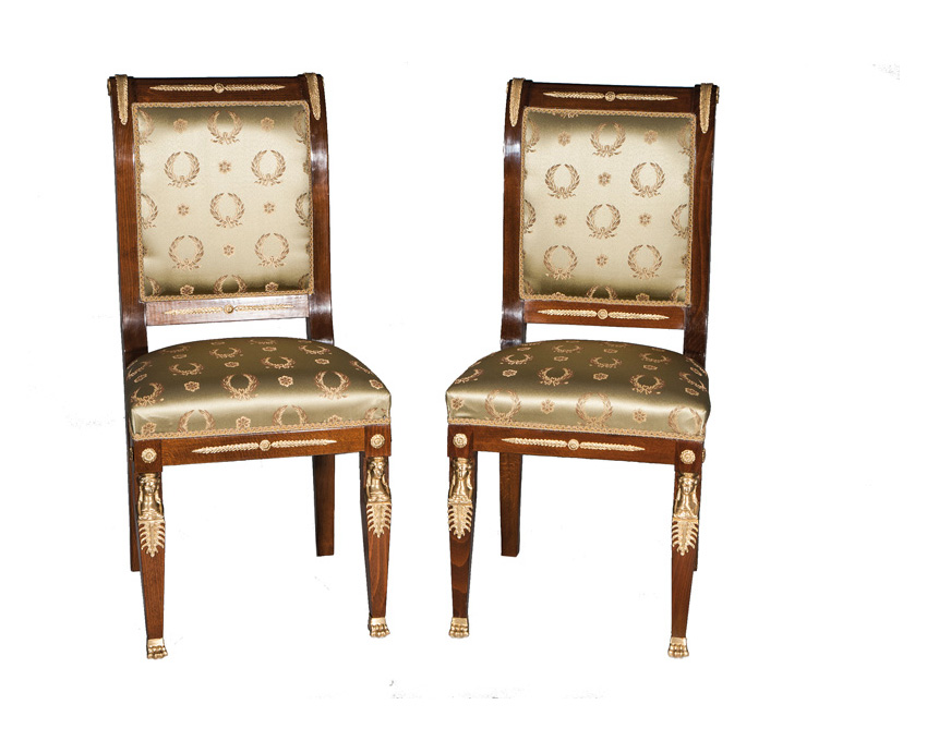 A pair of chairs of Empire style