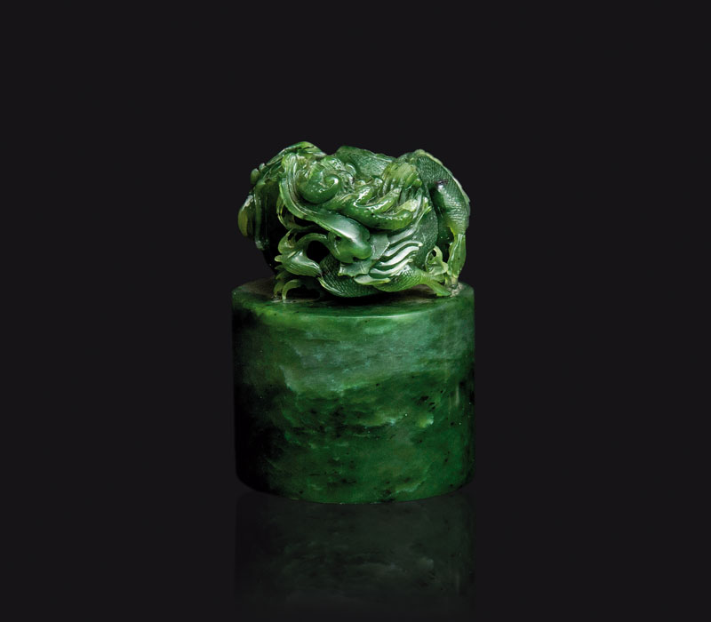 A spinach-green jade seal with dragon and pearl