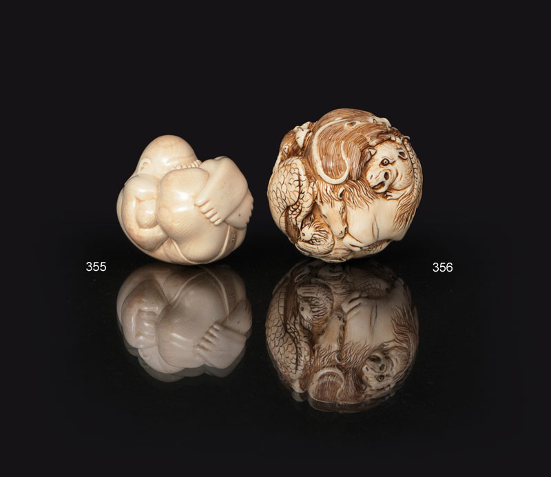 An unusual ivory ball with zodiacs