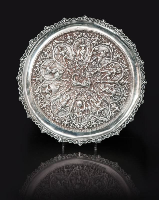 A large silver platter with Hinduistic relief