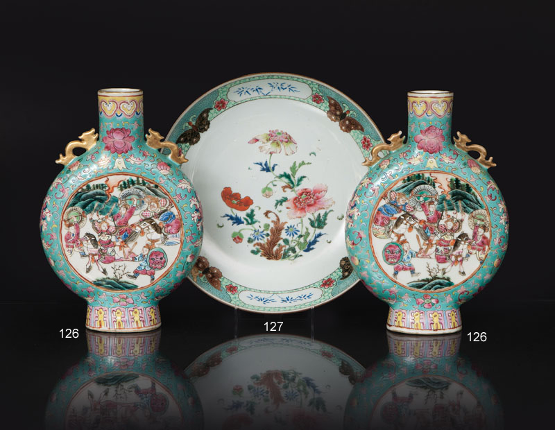 A pair of 'Famille Verte' moonflasks with battle scenes and phoenix birds