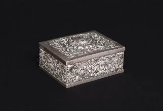 A silver box with floral decoration