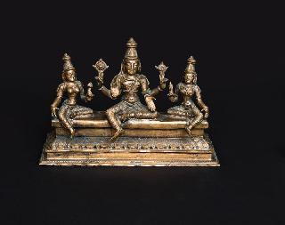 A bronze trias 'Vishnu and his consorts Bhu and Sri'