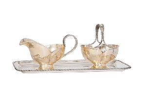 A tray with sugar bowl and creamer