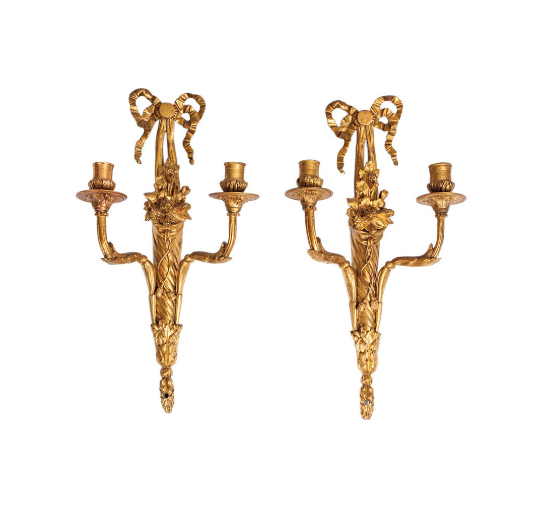 A pair of gilded Empire walllights