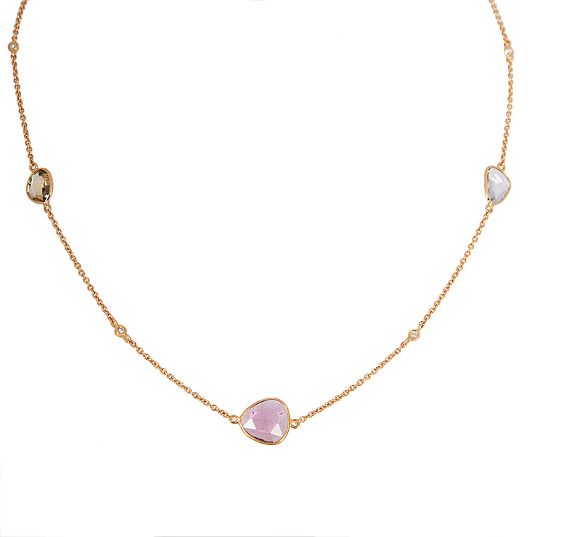 A petite necklace with colourful sapphires