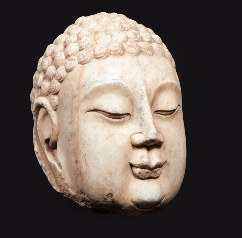 A large and rare marble-head of a buddha