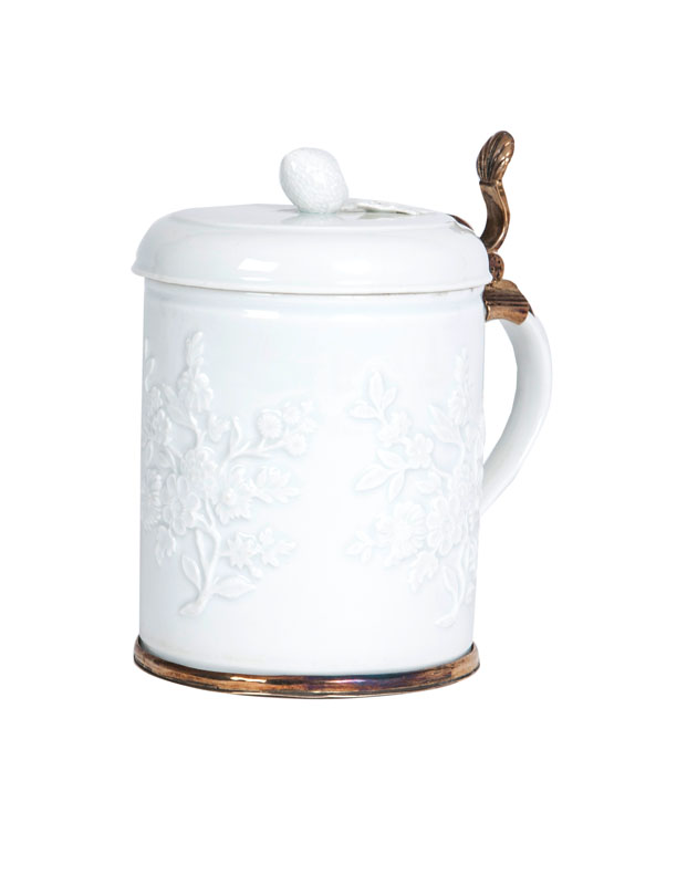 An armorial tankard with flower relief