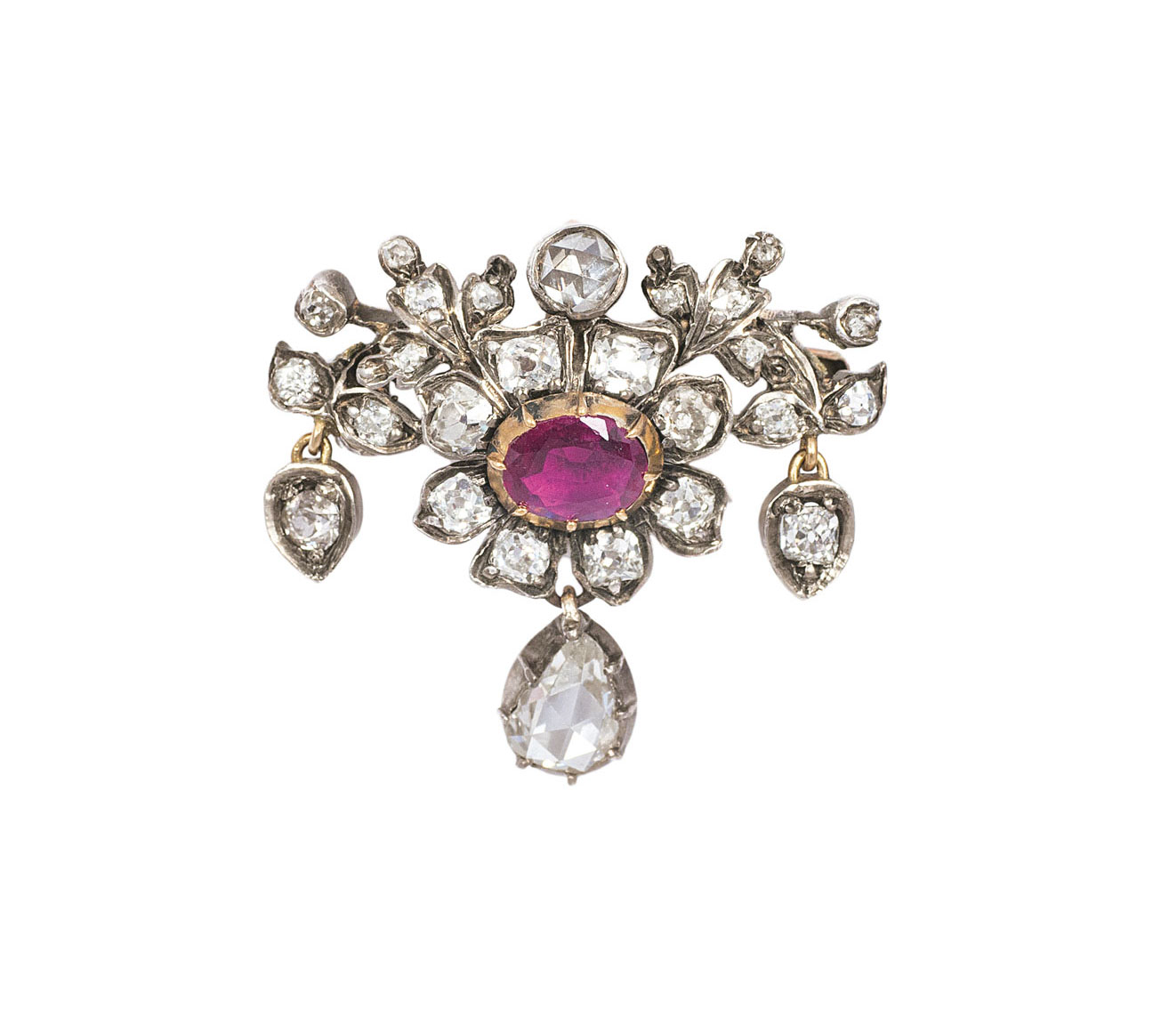 A small, antique diamond ruby brooch