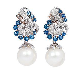 A pair of Southsea pearl earrings with sapphires and diamonds