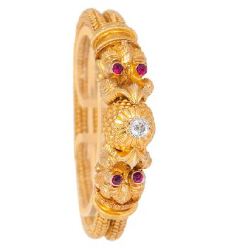 A golden bracelet with old cut diamonds and rubies in the style of the antique era