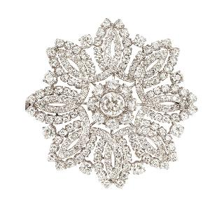 A large, highcarat diamond brooch