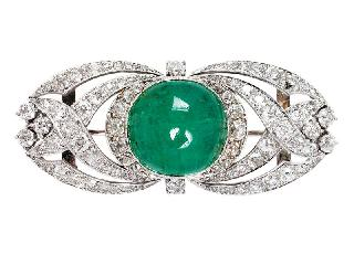 An Art Déco emerald brooch with diamonds