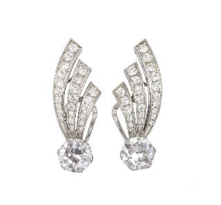 A pair of highcarat diamond earrings