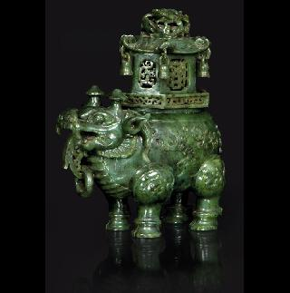 A rare and exquisite spinach green jade censer in the shape of a mythical beast