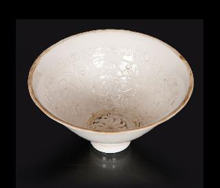 A small conical bowl with peonies