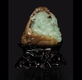 A fine two-tone jade-carving of Budai