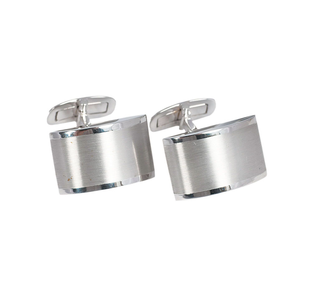 A pair of golden cuff links by Wempe