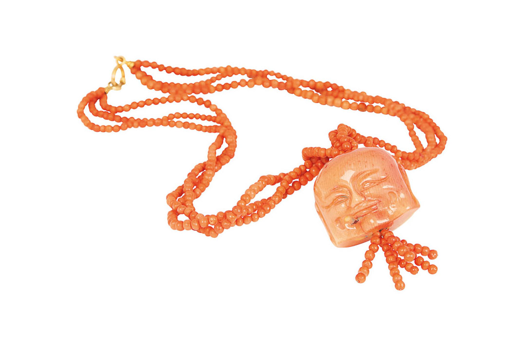 A coral necklace with large coral pendant 'Masks'