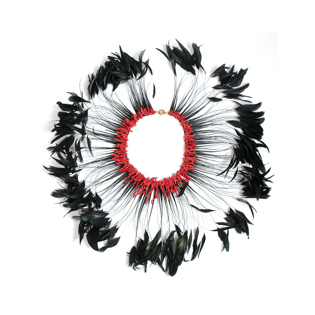An extravagant coral feather necklace