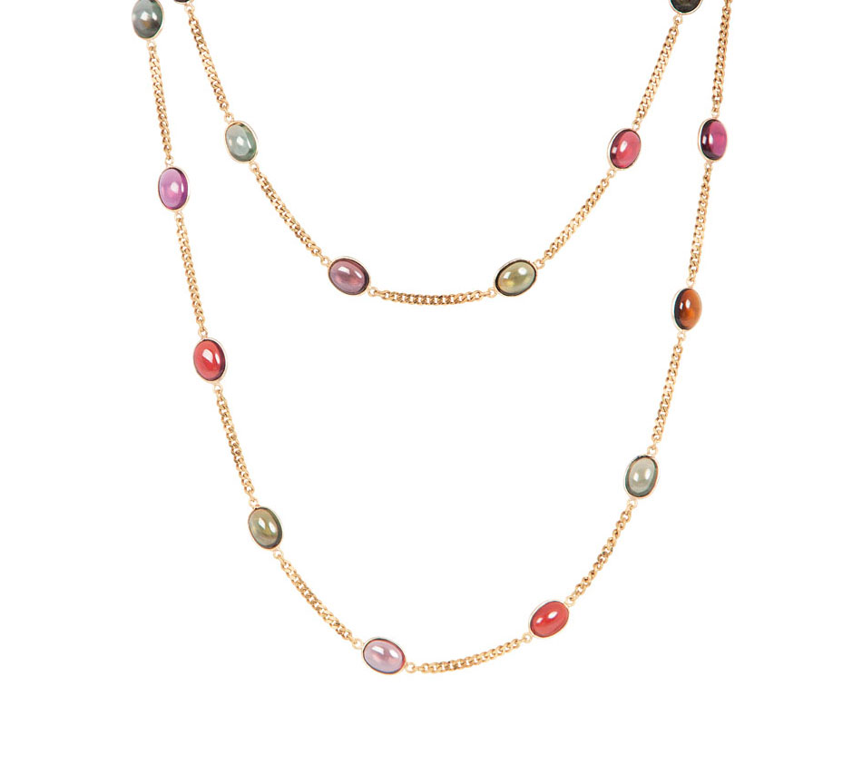 A long golden necklace with tourmalines