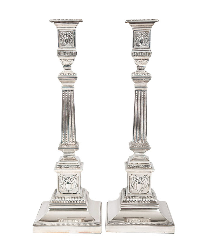 A pair of candlesticks of column-shape