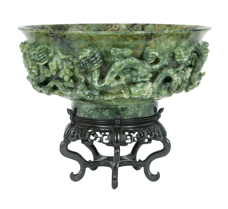 A large spinach green jade bowl with dragon decor