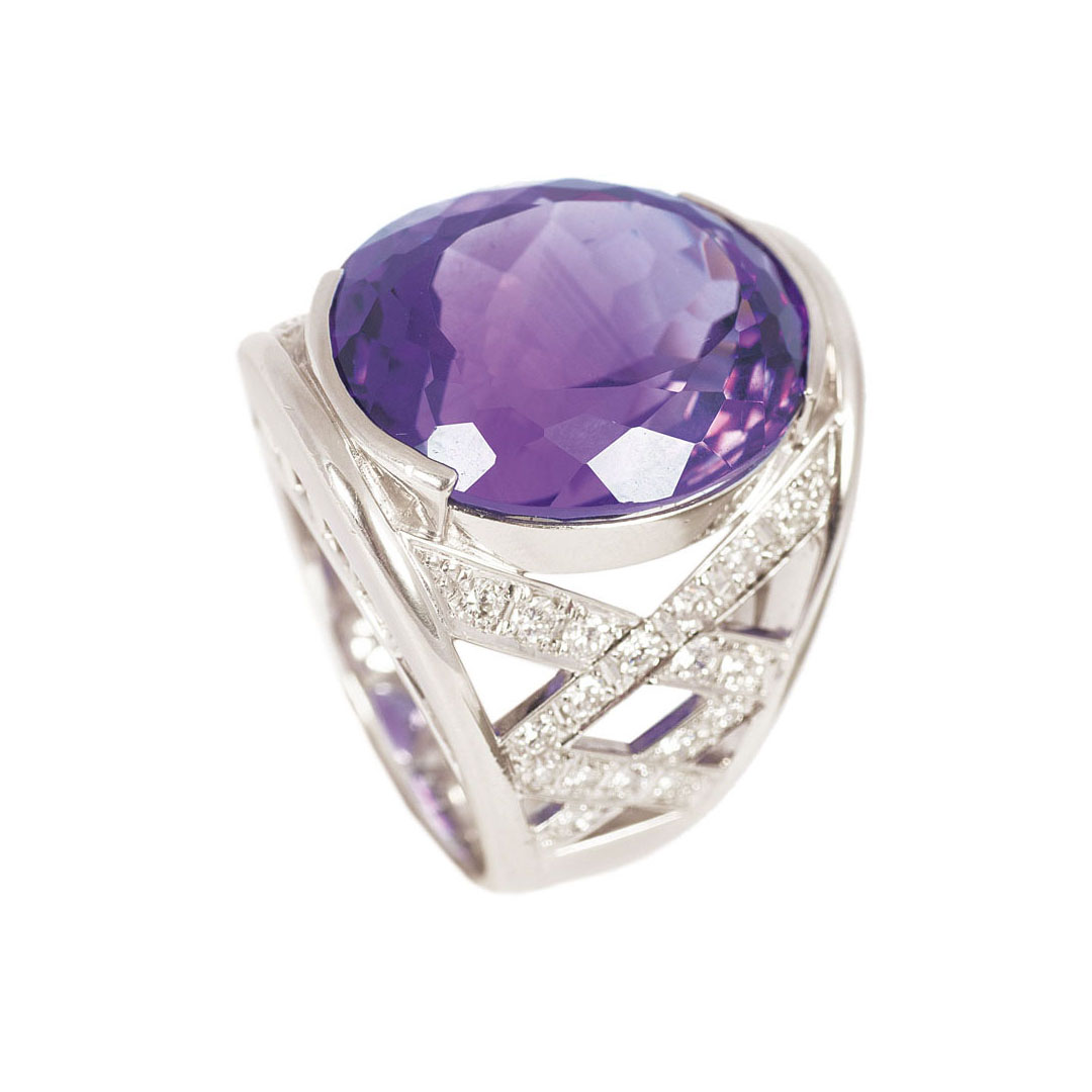 A platinum amethyst ring with diamonds