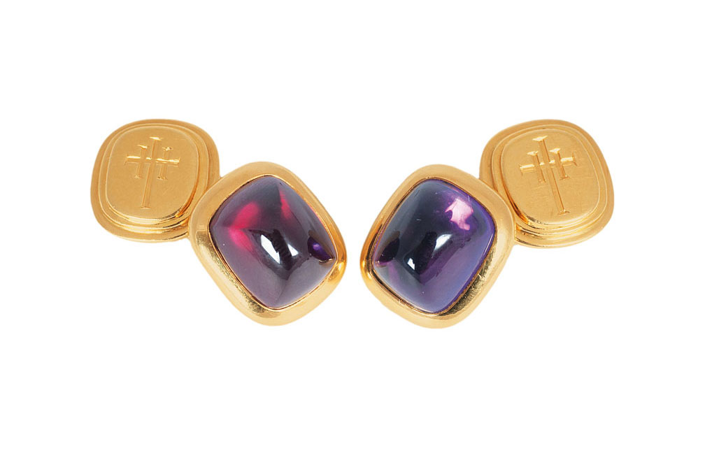 A pair of cufflinks with 3 varying coloured stone for exchanging