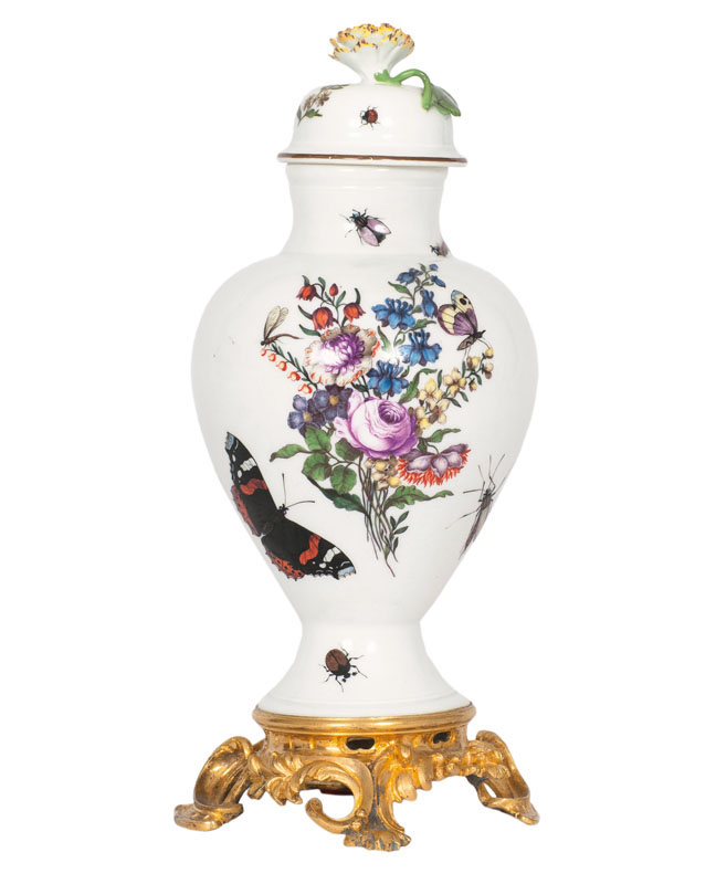 A covered vase with German flowers and insects