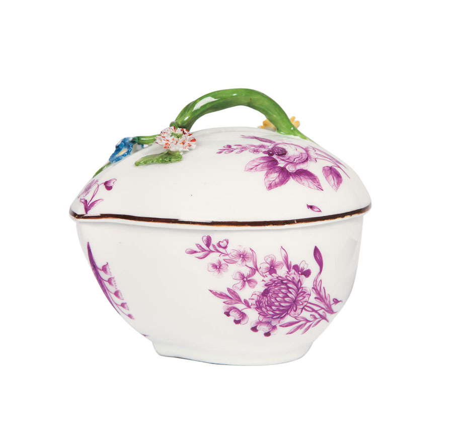 A lidded box with woodcut flowers